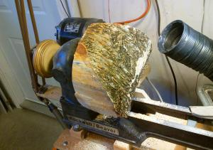 Wood mounted on lathe